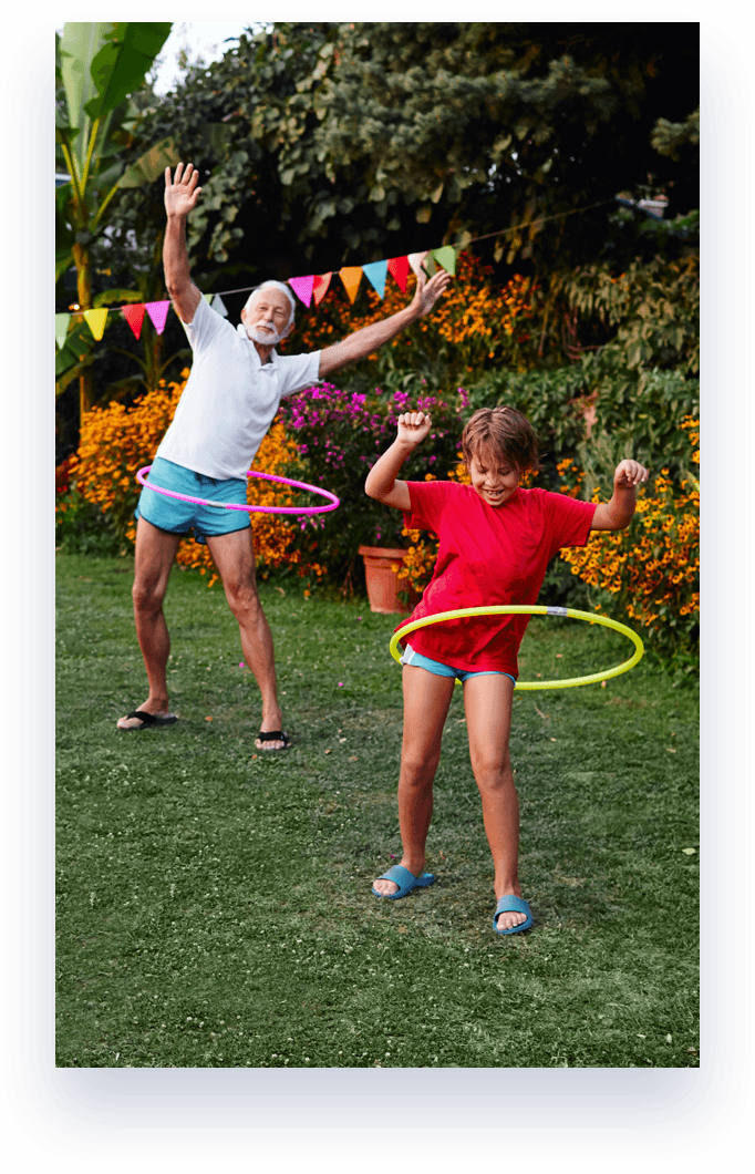 grandfather and grandchild hula hooping