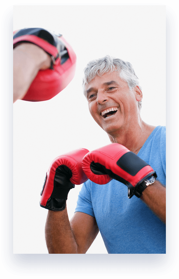 man laughing wearing boxing gloves